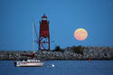 Red Lighthouse & Full Moon by Brad Jaeck