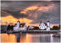 Spectacular Sunset at Coast Guard Station by Carol Hansen