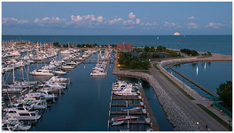 Moonrise over Reefpoint Marina by Carol Hansen